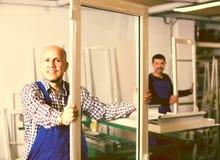 Работники с окнами и дверями PVC Стоковые Изображения RF