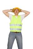 работник вспугнутый конструкцией стоковая фотография rf