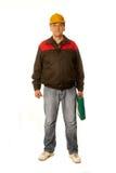 Работник в желтой трудной шляпе с зеленым чемоданом Стоковое фото RF