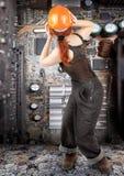 работник девушки с волосами красный стоковая фотография rf