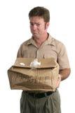 работник доставляющий покупки на дом огорченный Стоковая Фотография