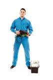 Работник держа сверло около резцовой коробки Стоковые Фото