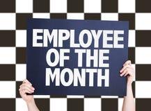 Работник карточки месяца на checkered предпосылке Стоковое Изображение RF