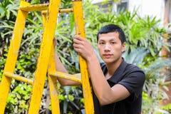 Работник на лестнице Стоковое фото RF