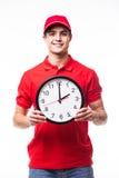 Работник доставляющий покупки на дом с часами Стоковые Фото