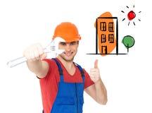 Работник при гаечный ключ показывая большие пальцы руки поднимает знак Стоковое Изображение