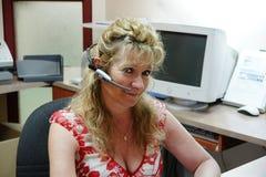 работник службы рисепшн наушников Стоковое фото RF