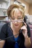 работник службы рисепшн телефона Стоковое фото RF
