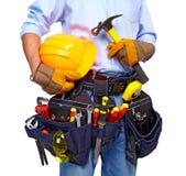 Работник с поясом инструмента. Конструкция. стоковые изображения