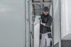 Работник с частью изоляции стоковые изображения