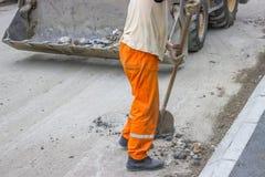 Работник физического труда с лопаткоулавливателем Стоковое фото RF