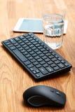 Рабочее место и стекло воды Стоковое фото RF
