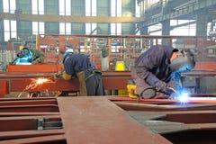 Рабочие сталелитейной промышленности стоковое изображение