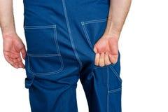 Рабочий класс в dungarees джинсовой ткани таща на ткани Стоковое фото RF
