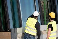 Рабочий-строители на работе на строительной площадке Стоковая Фотография RF