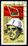 Рабочий-строитель, Съезд Партии serie SED, около 1971 стоковое фото