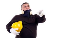 Рабочий-строитель указывая вперед Стоковые Изображения