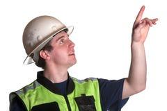 Рабочий-строитель в куртке безопасности стоковые изображения