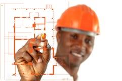 Рабочий-строитель делая эскиз к светокопиям Стоковые Фотографии RF
