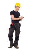 Рабочий-строитель принимая примечание Стоковое Фото