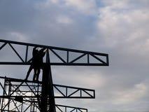 Рабочий-строитель промышленного сектора людей силуэта тяжелый Стоковое Изображение RF