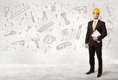 Рабочий-строитель строгая с нарисованными рукой значками инструмента Стоковая Фотография