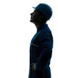 Рабочий-строитель человека смотря вверх портрет силуэта профиля Стоковое фото RF