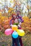 Радостная семья в природе Стоковая Фотография