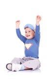 Радостное усаживание мальчика Стоковое Изображение