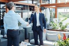 Радостные успешные бизнесмены смотря один другого Стоковое Изображение RF