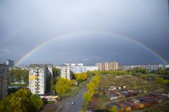 Rainbow over the city Backdrop background with space for text Стоковая Фотография