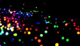 Радуга Bokeh освещает в много различных, ярких, и милых цветов Стоковые Изображения RF