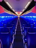 Разбивочное междурядье пустого самолета стоковое фото
