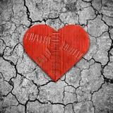 Разбитый сердце на сухой почве Стоковое Изображение