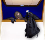 Разбойник входит в дом Стоковые Изображения
