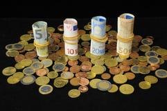Разбросанные деньги стоковое фото