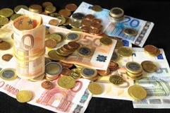 Разбросанные деньги стоковые изображения