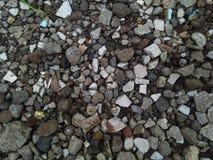 разбросан гравий и много для небольшого камешка стоковое изображение