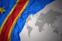 Развевая красочный национальный флаг Демократической Республики Конго Стоковая Фотография RF