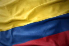 Развевая красочный флаг Колумбии Стоковые Изображения
