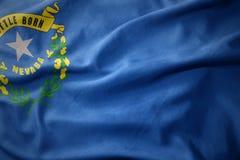 Развевая красочный флаг положения Невады стоковые фото