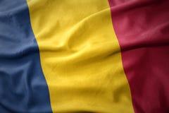 Развевая красочный флаг Чада Стоковое Фото