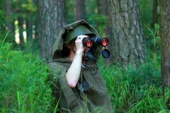 Разведчик в лесе Стоковая Фотография