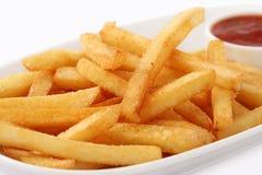 Разделайте свежо сделанных frites pommes стоковые фото