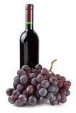 разлейте виноградины по бутылкам стоковое изображение rf