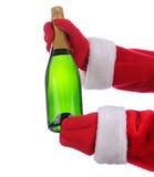 разлейте шампанское по бутылкам santa стоковая фотография