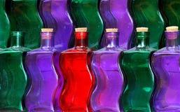 разливает цветастое по бутылкам Стоковое Изображение