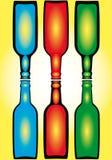 разливает цветастое по бутылкам Стоковая Фотография