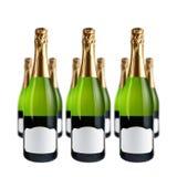 разливает шампанское по бутылкам Стоковое Изображение
