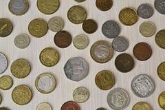 Различные монетки различных стран Стоковые Фото